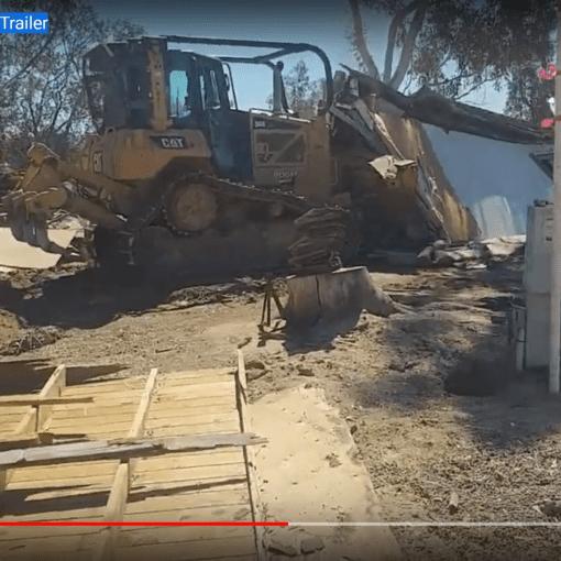 Bulldozer-Levels-Old-Farm-Trailer